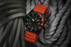 Luminox Bear Grylls Survival SEA 3720 Series 3729.NGU Black/Orange Front Side Closed Angled With Background