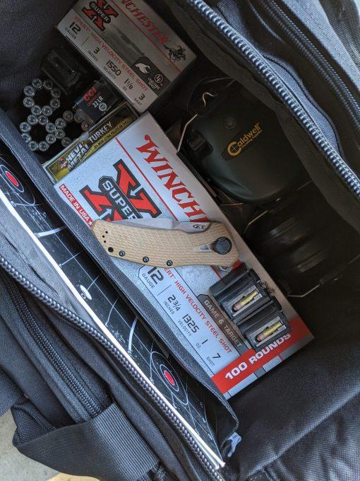 Zero Tolerance 0308 20CV Blade Coyote G-10/Titanium Handle With Background 5
