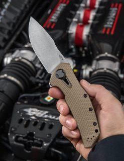 Zero Tolerance 0308 20CV Blade Coyote G-10/Titanium Handle With Background 6