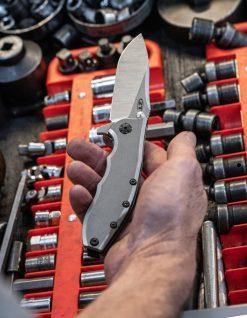 Zero Tolerance 0562TI 20CV Blade Stonewashed Titanium Handle Front Side Open With Hand