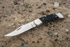 Buck Knives 110 Pro Folding Hunter S30V Clip Point Blade - Black G-10/Nickel Front Side Open On Ground