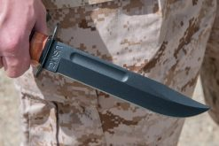 Ka-Bar USMC Fighting Knife 1095 Blade Brown Leather Handle In hand