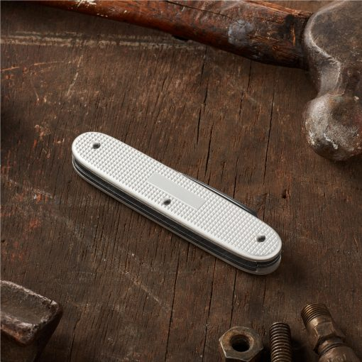 Victorinox Electrician Pocket Knife Silver Alox Back Side Closed On Ground