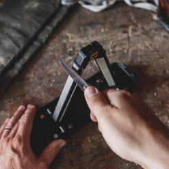 Work Sharp Angle Set Sharpener with Tri-Brasive Front Side With Hands 1