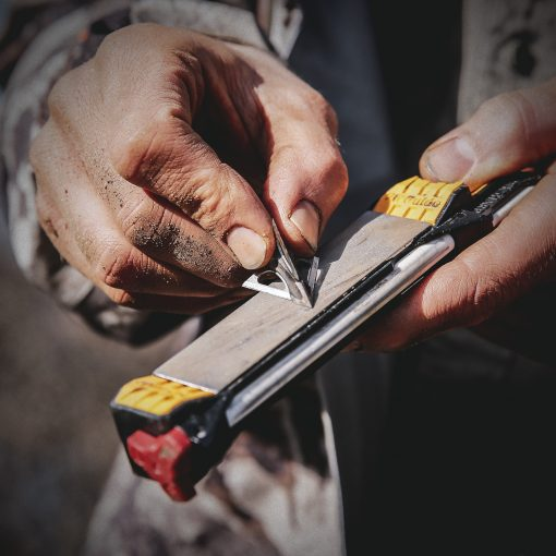Work Sharp Guided Field Sharpener In Use With Hands 5