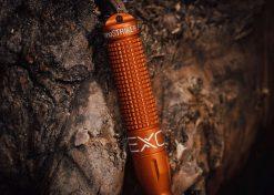 Exotac nanoSTRIKER XL Self-Contained Ferrocerium Firestarter - Orange Body Close Up With Background